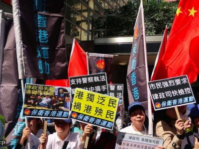 Hong Kong Police and Pro-Beijing Groups Protest After Court Convicts Officers of Assaulting Activist