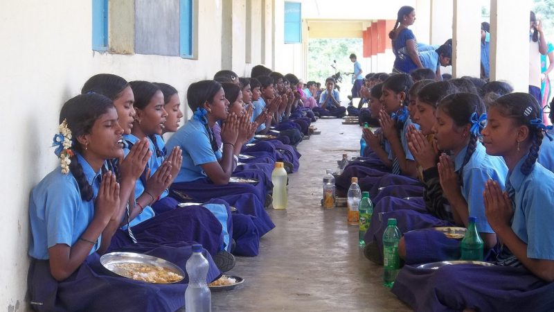 Lunch at a public school in India. Image from Flickr by Trinity Care Foundation. CC BY-NC-ND 2.0