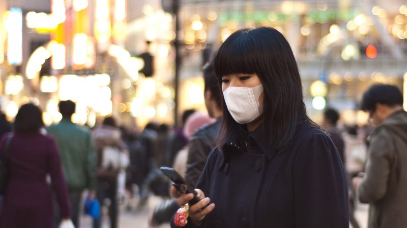 A Japanese woman wearing a surgical mask.