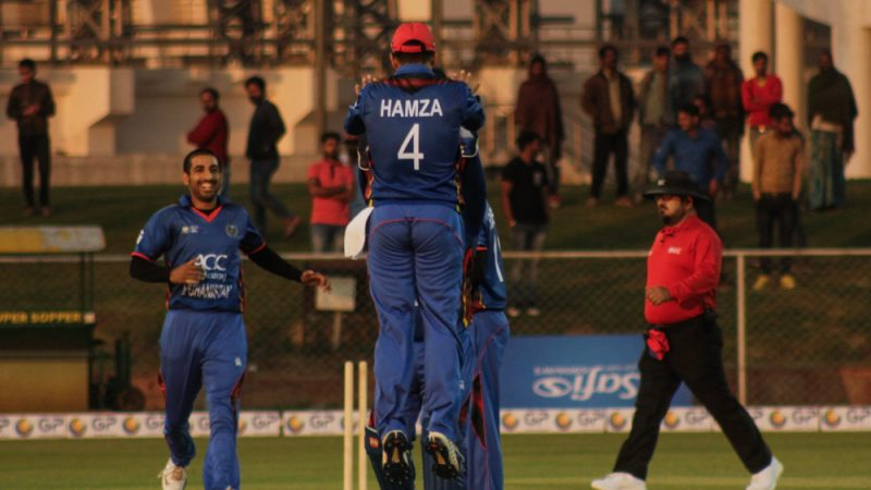 The Afghan team cheers the fall of an Irish wicket. Image by Ieshan Wani.