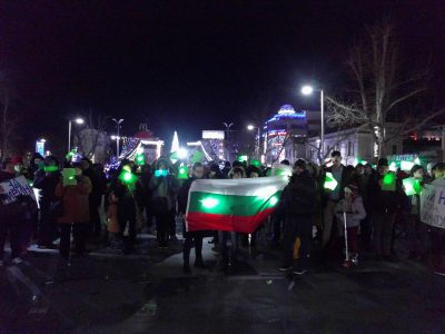 Demonstrators sheding green lights to impersonate a Pirin forest, Burgas, Bulgaria.