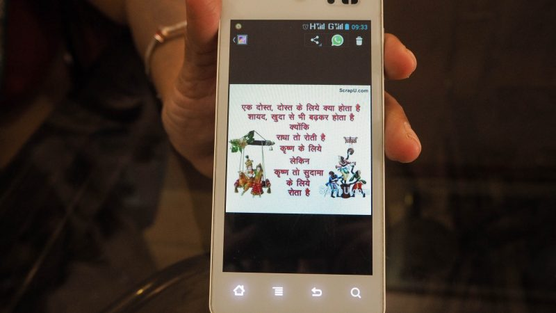Practices in India: Sending daily religious quotes in Hindi language through WhatsApp. Image from Flickr by Lau Ray.