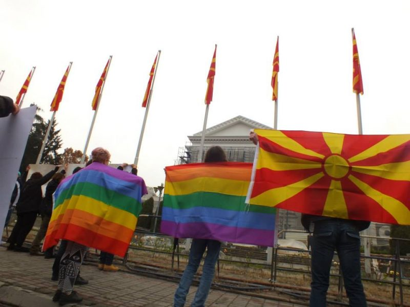 People with Macedonian flag and the Rainbow flags in front of government of Republic of North Macedonia