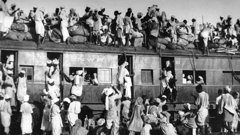 Overcrowded train transferring refugees during the partition of India, 1947. This was considered to be the largest migration in human history. Image via Wikipedia. Public Domain