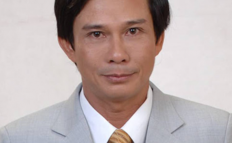 M. Ngo Xuan Hao, face caméra, l'expression neute, vêtu d'un costume-cravate.