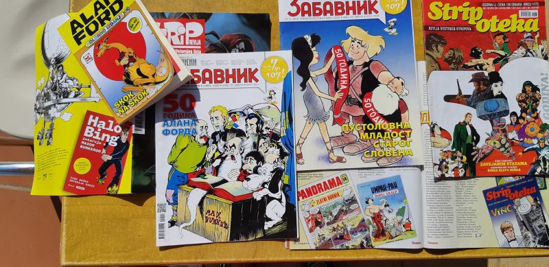 Comics magazines from Croatia and Serbia on a table.