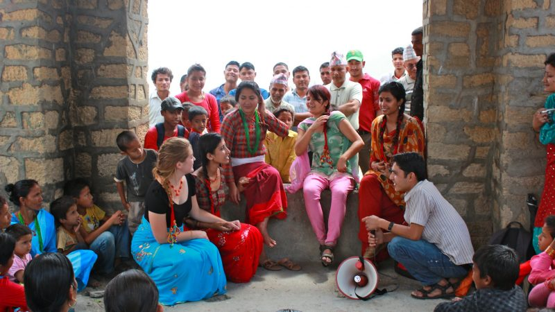 Mass Community Health Teaching - Street Theater discussing Chhaupadi. Image from Flickr by Possible/Nyaya Health. CC BY 2.0