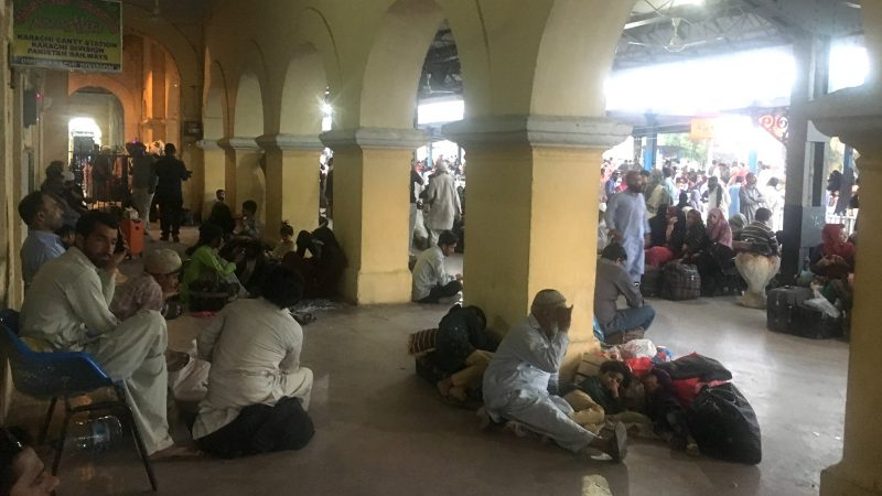 A large number of people are waiting at the main railway station at Karachi. Image by Sheema Ghani, used with permission