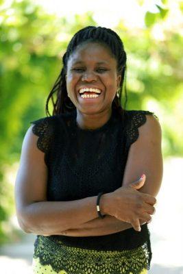Kpénahi Traoré, arborant un large sourire.