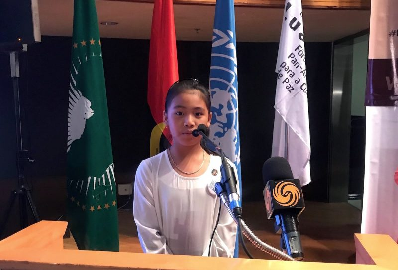 Licypriya addressing UNESCO Partners' Forum 2019 (Biennial Luanda) in Angola on 20 September 2019. Image via Wikimedia Commons by Dilanlekamge. CC BY-SA 4.0.