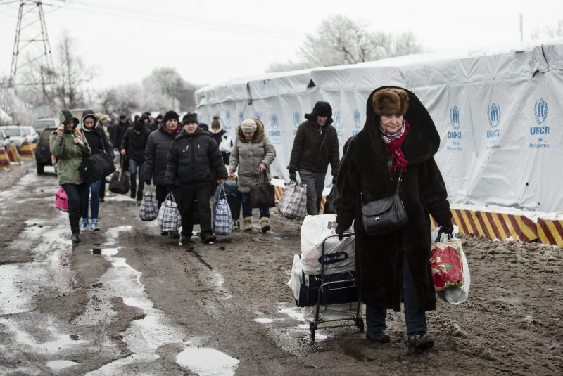People rush to the bus stop at the border crossing point in Mayorsk, Donetsk area on December 27, 2016.