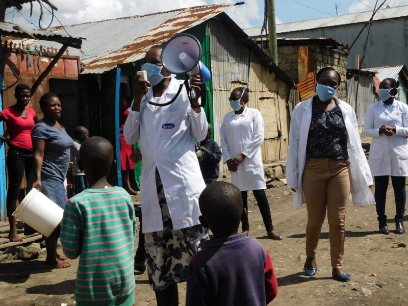 """""""Information and awareness is important to prevent the spread of COVID-19. Here in Kenya, Clinical Health care workers are sensitising the community on COVID-19. Photo : Victoria Nthenge"""" by Trocaire is licensed under CC BY 2.0"""