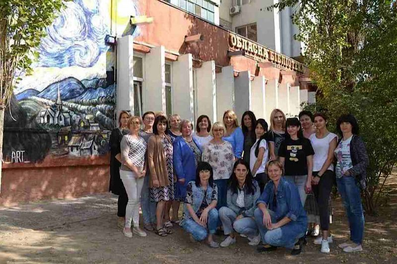 Library staff pose in front of the Borys Lavrenyov Regional Library for Youth. Photo courtesy of Rubryka and TOL.